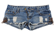 Old worn jean shorts isolated on white background. Old and worn blue jean shorts isolated on a white background stock photos