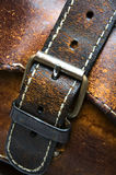 Old worn leather bag buckle detail. Buckle detail old worn hand made leather bag produced athens greece Royalty Free Stock Images