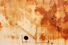 Old worn metal surface with paint. Rusty metal texture. Metal sheet with rust and worn paint, metal plate texture stock photo