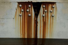 Old worn metal surface with paint. Rusty metal texture. Metal sheet with rust and worn paint, metal plate texture royalty free stock photo