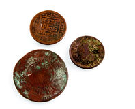 Old worn Nepalese coins. Royalty Free Stock Images