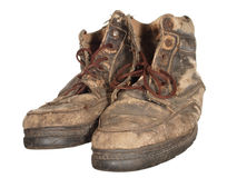 The old worn out boots with brown laces isolated on white backgr Stock Photos