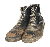 The old worn out boots with white laces isolated on white backgr Royalty Free Stock Image