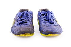 Old worn out dirty blue futsal sports shoes on white background football sportware object isolated