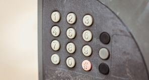 Old worn out and dirty keypad on a street Royalty Free Stock Images