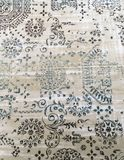 Old worn out elegant damask pattern carpet / floor covering. Luxury grunge vertical background. Old worn out elegant damask pattern carpet / floor covering royalty free stock photography