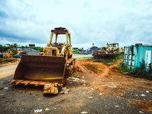 Old worn out equipment for iron ore mines in Liberia, West Africa. Old worn excavator at the limit of its capabilities. Iron ore mining in Liberia, Africa Stock Images