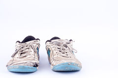 Old worn out futsal sports shoes  on white background   Royalty Free Stock Photography