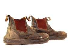 Old worn out leather dirty work boots Royalty Free Stock Photography