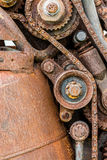 Old worn out rusty gear wheels and sprocket. Closeup Stock Photography