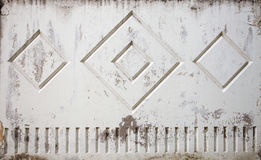 Old worn out stained shabby rough concrete gray fence wall Royalty Free Stock Images