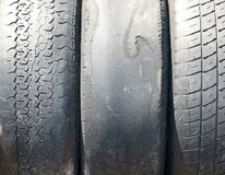 Old worn-out summer tires. With worn-out protector close-up stock photo