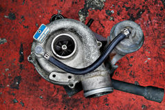 Old worn out turbocharger of a turbo diesel engine Stock Photos