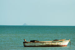 Old Canoe in Atlantic Ocean Stock Image