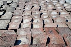 Old worn pavement tiles after dismantling from the streets of the city. Urban economy royalty free stock image