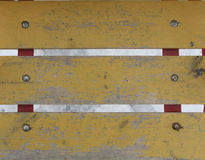 Old worn planks painted with yellow paint. Older horizontal boards with faded yellow paint stock images