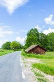 Old Worn Red Barn Near Road Royalty Free Stock Photos