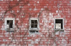 Three Windows in an Old Red Barn Stock Photos