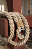 Old worn rope on a red pole Royalty Free Stock Photo