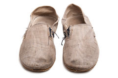 Old worn slip on shoes Royalty Free Stock Photography