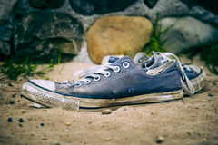 Old worn sneakers Stock Photo