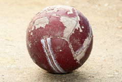 Old worn soccer ball. Lying on the ground Royalty Free Stock Image