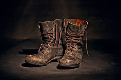 Old worn soldiers work boots Stock Photo