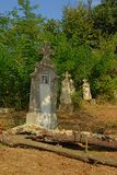Old Stone grave monuments in the Romanian countryside. Old worn stone gravetombs in nature in the Transylvanian countryside, Romania royalty free stock photo