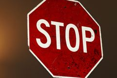 Old worn stop sign on wall Royalty Free Stock Photos