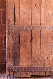 Old worn strong wooden door Stock Photos