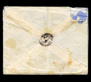 Old, worn and tattered envelope. Old, tattered envelope, isolated on black background Stock Photography