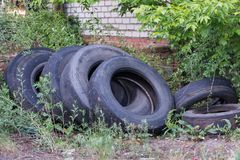 Old worn tires are a big pile in a landfill. Old discarded used tires in a heap. Environmental pollution royalty free stock photos