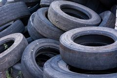 Old worn tires are a big pile in a landfill. Old discarded used tires in a heap. Environmental pollution stock image