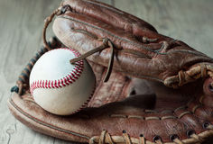 Old and worn used leather baseball sport glove over aged Royalty Free Stock Photo