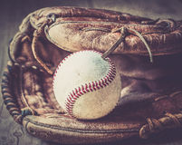 Old and worn used leather baseball sport glove over aged Royalty Free Stock Images