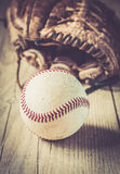 Old and worn used leather baseball sport glove over aged Royalty Free Stock Image