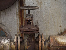 Old worn valve in factory Stock Images