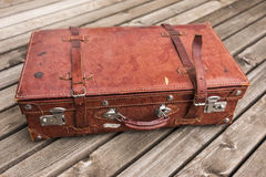 Old worn vintage brown leather suitcase Royalty Free Stock Image