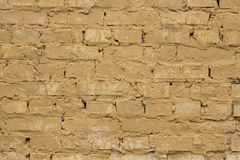 Old worn yellow brick wall background. Royalty Free Stock Images