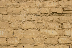 Old worn yellow brick wall background. royalty free stock image