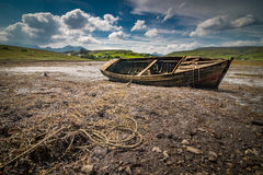 Old wreck boat. Old wreck fishing boat lying on the dry bottom of the sea during outflow Stock Photos
