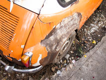 Old wreck car. In orange color Royalty Free Stock Photography