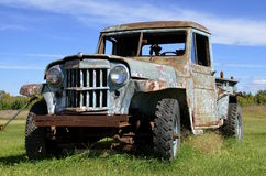 Old wrecked beat-up pickup Stock Image