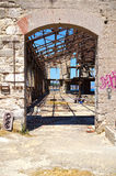Old wrecked factory. Entrance of an old, wrecked factory building at Piraeus industrial zone, Athens - Greece Stock Photography