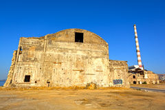 Old wrecked factory. View of an old, wrecked factory buildings at Piraeus industrial zone, Athens - Greece Royalty Free Stock Images