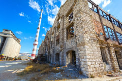 Old wrecked factory. View of an old, wrecked factory buildings at Piraeus industrial zone, Athens - Greece Stock Image