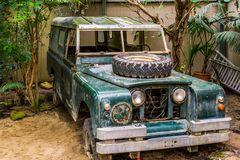 Old wrecked jeep that is being used as kid toy, decorative vintage objects. A old wrecked jeep that is being used as kid toy, decorative vintage objects stock image