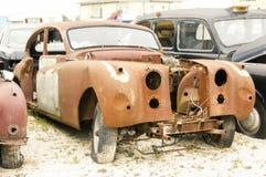 Old wrecked rusty british car. In a car wreckyard Stock Image