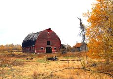 Old Wrecks. An old red barn with old rusty equipment around it Royalty Free Stock Image