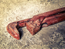 Old wrench on concrete closeup Royalty Free Stock Photos
